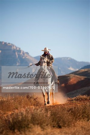 Cowgirl with Lasso Riding Quarter Horse, Wyoming, USA Stock Photo - Rights-Managed, Image code: 700-03407472