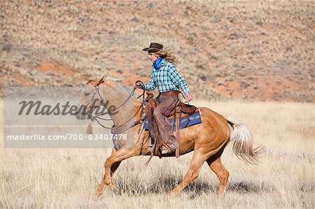 Cowgirl Riding Quarter Horse, Wyoming, USA Stock Photo - Rights-Managed, Image code: 700-03407478