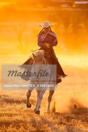 Cowgirl Riding Horse at Sunset, Wyoming, USA Stock Photo - Rights-Managed, Image code: 700-03407485