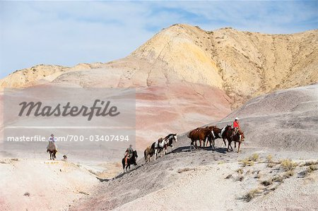 Cowboys Driving Herd of Horses through Badlands, Wyoming, USA Stock Photo - Rights-Managed, Image code: 700-03407494