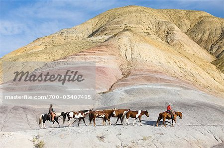 Cowboys Driving Herd of Horses through Badlands, Wyoming, USA Stock Photo - Rights-Managed, Image code: 700-03407495
