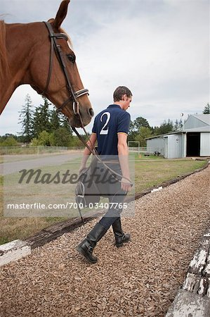 Polo Player Leading Horse, Brush Prairie, Washington, USA Stock Photo - Rights-Managed, Image code: 700-03407765