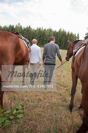 Couple Leading Horses, Brush Prairie, Washington, USA Stock Photo - Rights-Managed, Image code: 700-03407773