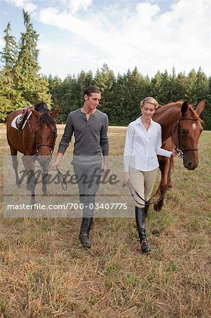 Couple with Horses, Brush Prairie, Washington, USA Stock Photo - Rights-Managed, Image code: 700-03407775