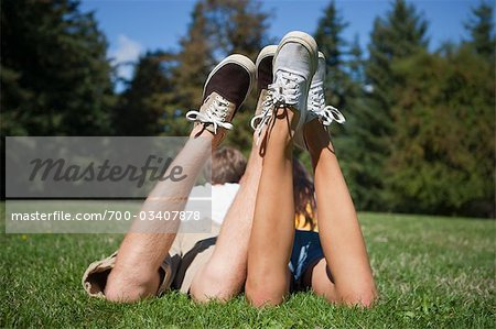 Teenage Couple Lying in Grass Stock Photo - Rights-Managed, Image code: 700-03407878