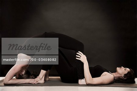 Two Women Doing Yoga Stock Photo - Rights-Managed, Image code: 700-03408082