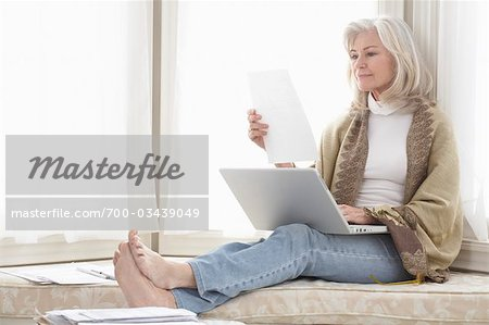 Woman at Home Using Laptop Computer Stock Photo - Rights-Managed, Image code: 700-03439049