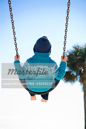Boy on Swing, Hernando Beach, Florida, USA Stock Photo - Rights-Managed, Image code: 700-03439227