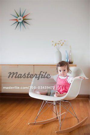 Baby Girl Sitting in a Rocking Chair Stock Photo - Rights-Managed, Image code: 700-03439472