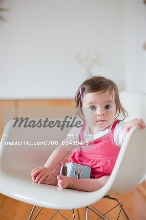 Baby Girl Sitting in a Rocking Chair Stock Photo - Rights-Managed, Image code: 700-03439473