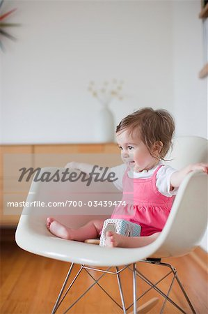Baby Girl Sitting in a Rocking Chair Stock Photo - Rights-Managed, Image code: 700-03439474