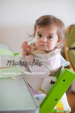 Baby Girl in Her High Chair Having Dinner Stock Photo - Rights-Managed, Image code: 700-03439477