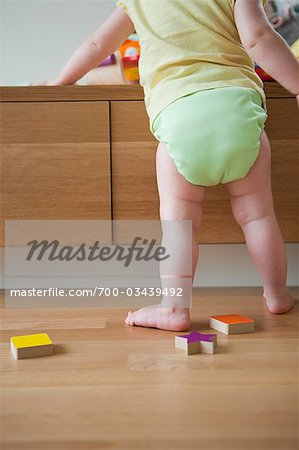 Baby Girl Playing With Toys Stock Photo - Rights-Managed, Image code: 700-03439492