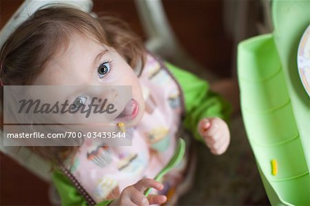 Overhead View of Little Girl Eating Lunch Stock Photo - Rights-Managed, Image code: 700-03439544