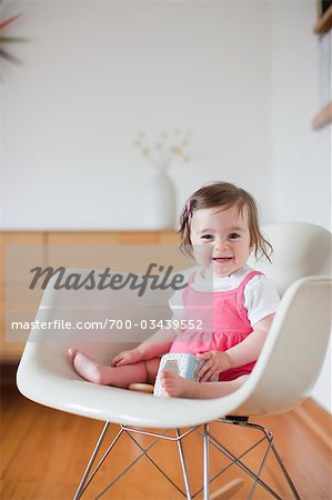 Portrait of Little Girl Sitting in Chair Stock Photo - Rights-Managed, Image code: 700-03439552