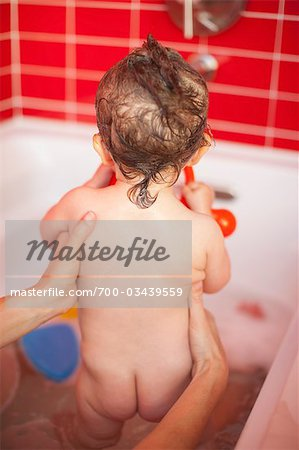 Back View of Baby Girl getting a Bath Stock Photo - Rights-Managed, Image code: 700-03439559