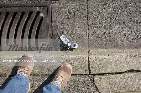Broken Cell Phone and Feet Stock Photo - Rights-Managed, Image code: 700-03439591