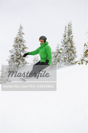 Man Snowboarding near Steamboat Springs, Colorado, USA Stock Photo - Rights-Managed, Image code: 700-03439862