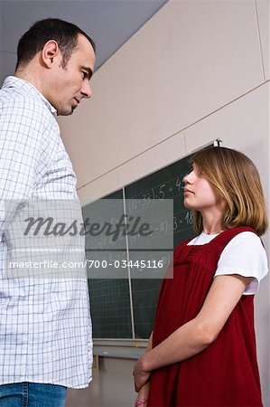 Student and Teacher Facing One Another Stock Photo - Rights-Managed, Image code: 700-03445116