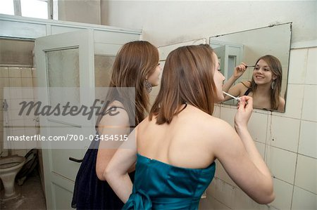 Teenage Girls Applying Make-up Stock Photo - Rights-Managed, Image code: 700-03454515