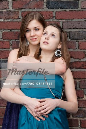 Teenage Girl Hugging Her Friend Stock Photo - Rights-Managed, Image code: 700-03454518
