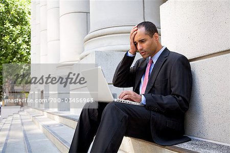 Businessman Using Laptop Outdoors Stock Photo - Rights-Managed, Image code: 700-03456963