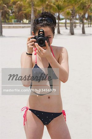 Teenage Girl on Beach wearing Bikini and taking Picture with Camera, Crandon Park Beach, Key Biscayne, Miami, Florida, USA Stock Photo - Rights-Managed, Image code: 700-03456979