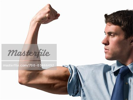 Businessman Flexing Bicep Stock Photo - Rights-Managed, Image code: 700-03466492