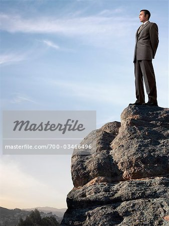 Businessman Standing on top of Cliff Stock Photo - Rights-Managed, Image code: 700-03466496