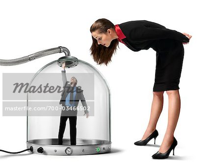 Businesswoman looking at Businessman inside of Pressurized Glass Dome Stock Photo - Rights-Managed, Image code: 700-03466502