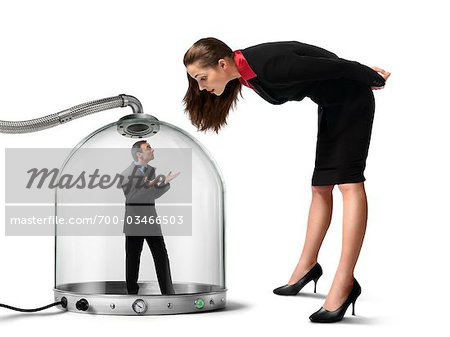 Businesswoman looking at Businessman inside of Pressurized Glass Dome Stock Photo - Rights-Managed, Image code: 700-03466503