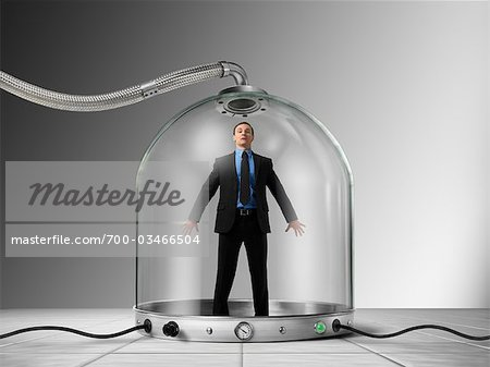 Businessman Trapped inside of Pressurized Glass Dome Stock Photo - Rights-Managed, Image code: 700-03466504