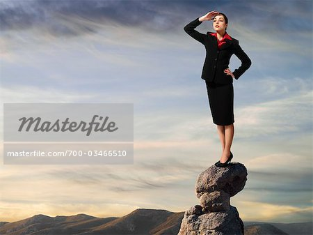 Businesswoman Standing on top of Cliff, Surveying Landscape Stock Photo - Rights-Managed, Image code: 700-03466510