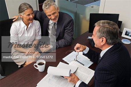 Mature Couple Talking with Financial Advisor Stock Photo - Rights-Managed, Image code: 700-03501272