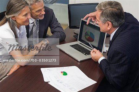 Mature Couple Talking with Financial Advisor Stock Photo - Rights-Managed, Image code: 700-03501273