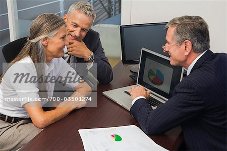 Mature Couple Talking with Financial Advisor Stock Photo - Rights-Managed, Image code: 700-03501274