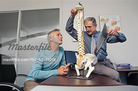 Mature Man Consulting with Doctor Stock Photo - Rights-Managed, Image code: 700-03501275