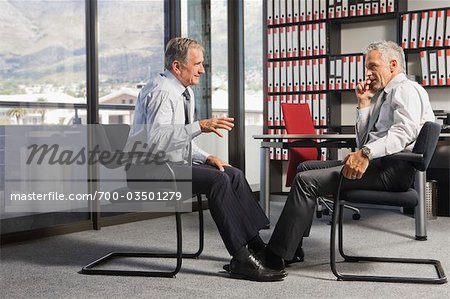 Two Businessmen Talking in Office Stock Photo - Rights-Managed, Image code: 700-03501279