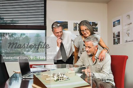 Mature Couple Discussing New Home Proposal with Architect Stock Photo - Rights-Managed, Image code: 700-03501281