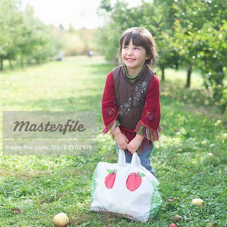 Little Girl in Apple Orchard Stock Photo - Rights-Managed, Image code: 700-03502976