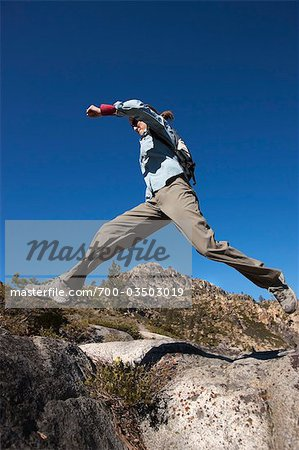 Woman Jumping from Rock to Rock at Donner Summit, near Lake Tahoe, California, USA Stock Photo - Rights-Managed, Image code: 700-03503019