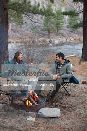 Couple Sitting Around Campfire, Truckee, near Lake Tahoe, California, USA Stock Photo - Rights-Managed, Image code: 700-03503046