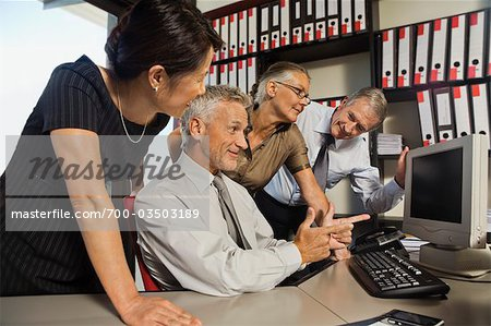 Coworkers Looking at Computer Together Stock Photo - Rights-Managed, Image code: 700-03503189