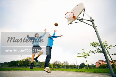 Father and Son Playing Basketball Stock Photo - Rights-Managed, Image code: 700-03506304