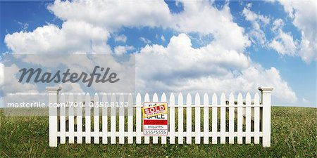 White Picket Fence with Sold Sign in Open Field Stock Photo - Rights-Managed, Image code: 700-03508132