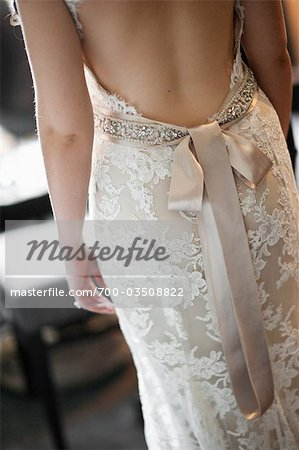 Close-Up of Bride Wearing Wedding Gown Stock Photo - Rights-Managed, Image code: 700-03508822