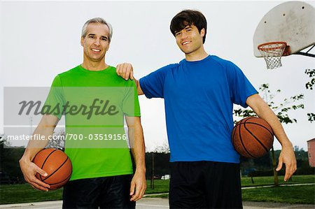Father and Son on Basketball Court Stock Photo - Rights-Managed, Image code: 700-03519156