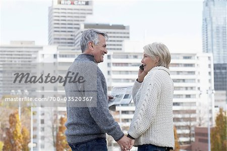 Couple Holding Hands with Buildings in background, Toronto, Ontario, Canada Stock Photo - Rights-Managed, Image code: 700-03520367