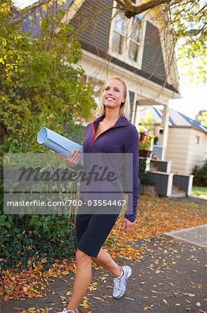 Woman carrying Yoga Mat, Seattle, Washington, USA Stock Photo - Rights-Managed, Image code: 700-03554467