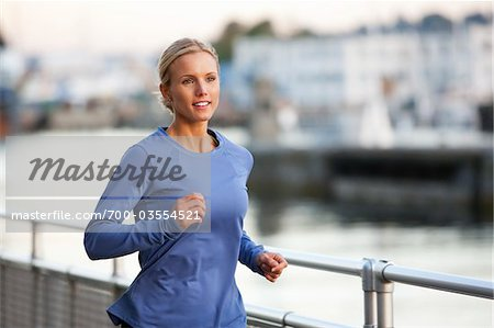 Woman Running at Sunset, Seattle, Washington, USA Stock Photo - Rights-Managed, Image code: 700-03554521